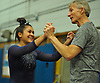 Jessica Lopez of Plainview-Old Bethpage JFK gets congratulated by assistant coach Dennis Jones after a vault in the Nassau County varsity gymnastics team championship at Berner Middle School in Massapequa on Thursday, Feb. 15, 2018.