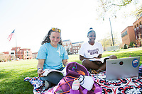 Enjoying warm springtime weather, Juliana Martinez and Quaneisha Clayton study psychology together at a shady spot on the Drill Field. Both freshmen from Petal, Martinez is a biological engineering/biomedical engineering major and Clayton is a biological sciences/pre-medicine major.<br />
