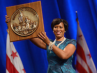 Washington, DC - January 2, 2015: D.C. Mayor Muriel Bowser raises the Seal of the District of Columbia after taking the oath office during the 2015 inauguration ceremony held at the Washington Convention Center, January 2, 2015.   (Photo by Don Baxter/Media Images International)
