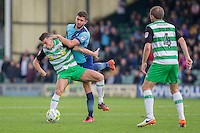 Kevin Dawson of Yeovil Town shields the ball from Dan Rowe of Wycombe Wanderers during the Sky Bet League 2 match between Yeovil Town and Wycombe Wanderers at Huish Park, Yeovil, England on 8 October 2016. Photo by Mark  Hawkins / PRiME Media Images.