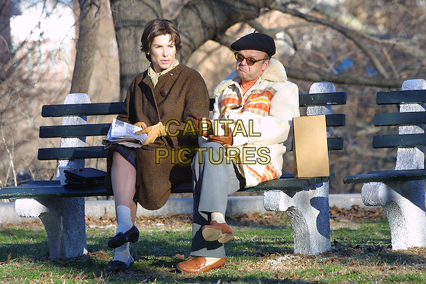 "SANDRA BULLOCK.On the set of ""Every Word I Say Is True""..Fort Greene Park, Brooklyn, New York..April 12th, 2005.Ref: IW.full length  short hair brown jacket sitting beret ankle socks legs crossed.www.capitalpictures.com.sales@capitalpictures.com.©Ian Wilson/Capital Pictures."
