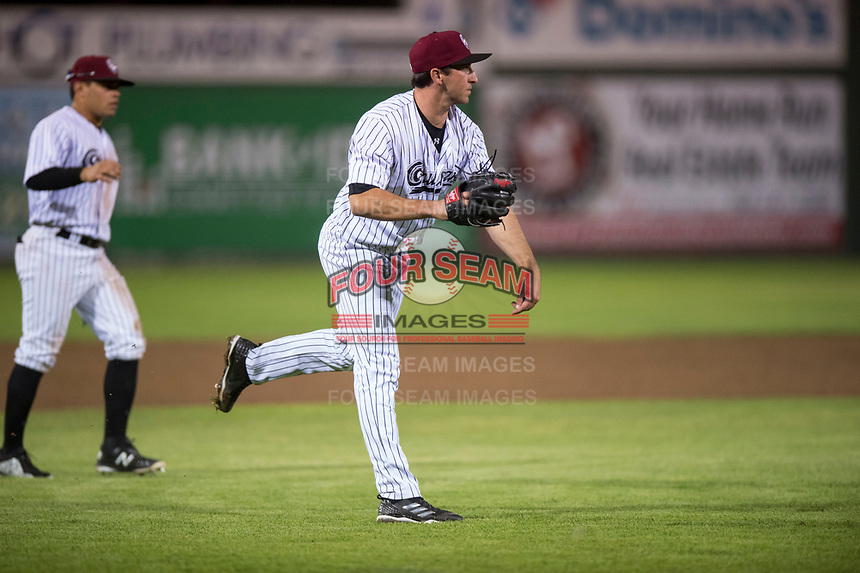 Idaho Falls Chukars relief pitcher Ted Cillis (24) follows through on a throw to first base during a Pioneer League game against the Billings Mustangs at Melaleuca Field on August 22, 2018 in Idaho Falls, Idaho. The Idaho Falls Chukars defeated the Billings Mustangs by a score of 5-3. (Zachary Lucy/Four Seam Images)