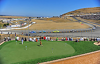 Jun. 21, 2009; Sonoma, CA, USA; Young fans play miniature golf in a sponsor suite area as NASCAR Sprint Cup Series drivers race through turn four during the SaveMart 350 at Infineon Raceway. Mandatory Credit: Mark J. Rebilas-