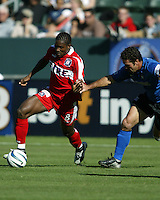 Damani Ralph dribbles away from Troy Dayak during MLS Cup 2003.  The San Jose Earthquakes defeated the Chicago Fire 4-2 in the MLS Championship at The Home Depot Center on November 23, 2003.