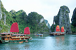 Halong Bay Sails 04 - Tourist junk cruise boats with red sails, Halong Bay, Viet Nam