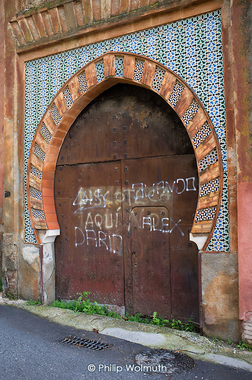 Mudejar style tiled and arched doorway in Sacromonte, Granada, Spain.