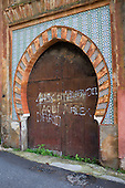 Mudejar style tiled and arched doorway in Sacromonte, Granada, Spain.
