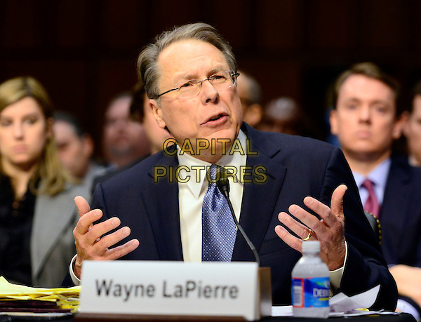 Wayne LaPierre, Executive Vice President and Chief Executive Officer,.National Rifle Association (NRA), is sworn-in to testify before the United States Senate Committee on the Judiciary hearing entitled 'What Should America Do About Gun Violence?' on Capitol Hill in Washington, D.C. on Wednesday, January 30, 2013. .half length hand America, American, Capitol Hill, Congress, U.S., US, USA, United States, domestic policy, government, guns, rifles, assault weapons, ban, semi-automatic weapons, law, legislation, legislative, legislature, national, news, people, political, politicians, politics.CAP/ADM/RS.©Ron Sachs/CNP/AdMedia/Capital Pictures.