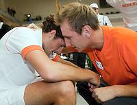 06-03-11, Tennis, Oekraine, Kharkov, Daviscup, Oekraine - Netherlands,  Robin Haase wint beslisende set, en wordt als eerste fefeliciteerd door zijn teamgenoot Thiemo de Bakker
