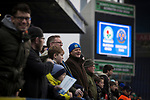Blackburn Rovers 3 Shrewsbury Town 1, 14/01/2018. Ewood Park, League One. Home supporters watching the players warming-up on the pitch before Blackburn Rovers played Shrewsbury Town in a Sky Bet League One fixture at Ewood Park. Both team were in the top three in the division at the start of the game. Blackburn won the match by 3 goals to 1, watched by a crowd of 13,579. Photo by Colin McPherson.