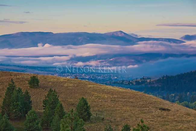 Low clouds over Missoula, Montana with Lolo Peak rising in the distance