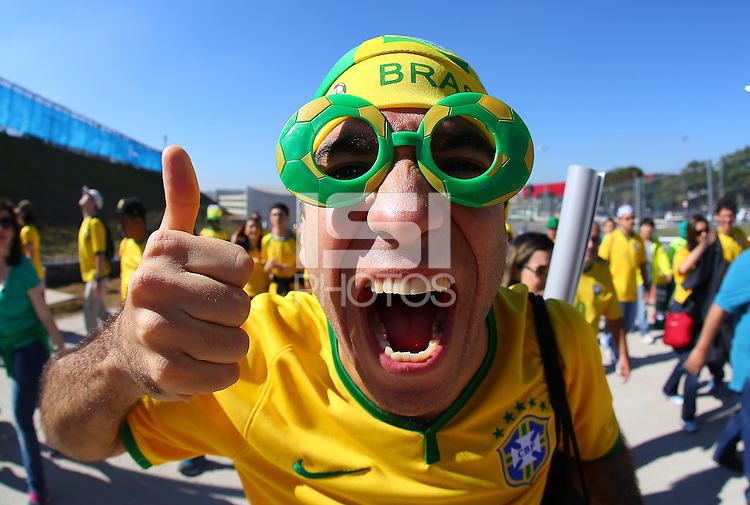 A Brazil fan soak up the atmosphere outside the Itaquerao stadium ahead of kick off in the opening match of the 2014 World Cup vs Croatia