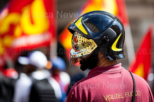 Unknown, Fire Fighter. <br /> <br /> Rome, 01/05/2019. This year I will not go to a MayDay Parade, I will not photograph Red flags, trade unionists, activists, thousands of members of the public marching, celebrating, chanting, fighting, marking the International Worker's Day. This year, I decided to show some of the Workers I had the chance to meet and document while at Work. This Story is dedicated to all the people who work, to all the People who are struggling to find a job, to the underpaid, to the exploited, and to the people who work in slave conditions, another way is really possible, and it is not the usual meaningless slogan: MAKE MAYDAY EVERYDAY!<br /> <br /> Happy International Workers Day, long live MayDay!