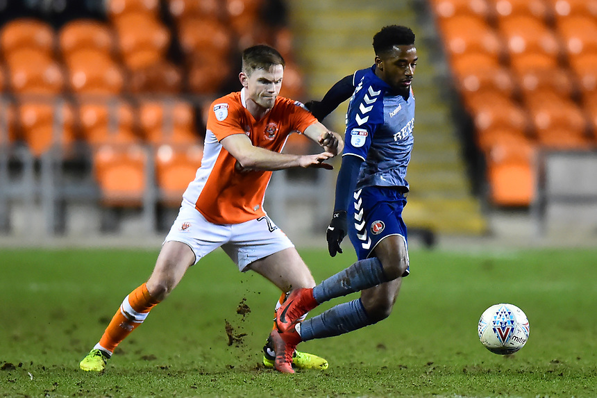 Blackpool's Oliver Turton competes with Charlton Athletic's Tariqe Fosu<br /> <br /> Photographer Richard Martin-Roberts/CameraSport<br /> <br /> The EFL Sky Bet League One - Blackpool v Charlton Athletic - Tuesday 13th March 2018 - Bloomfield Road - Blackpool<br /> <br /> World Copyright &not;&copy; 2018 CameraSport. All rights reserved. 43 Linden Ave. Countesthorpe. Leicester. England. LE8 5PG - Tel: +44 (0) 116 277 4147 - admin@camerasport.com - www.camerasport.com