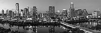 Austin Skyline From Above Pano BW - Another Aerial Austin skyline in black and white with the latest view along Lady Bird Lake with the hike and bike trail along the waters edge at twilight. This austin skyline includes the new tallest building in the cityscape the Independent or Jingle as some call it, plus our second tallest the Austonian, plus the Google new home, the Northshore condos which have been added recently, along with the W building, the Bowie, the Ashton and another new one at the far end the Fairmont Hotel and so many others its hard to name them all. Oh lets not forget the Frost building just barely peeping out from behind the Ashton and other new arrivals. Another city high rise you can just barely see anymore is the Austin 360 as the new high rises have almost completely block its view from here. Austin is a fast growing city with all of it sky-scrapers built in the last ten year so it is has a modern cityscape in downtown and is constantly changing for good or bad. Much of the growth of the city growth has been the large number of high tech companies which have move here to the city in the last five year or so. Austin is also the state capital and it is home to a major school the University of Texas. The city contines to draw tourist and people wanting to vist or live in this lively modern city with it well know night life being the music capital of the world and it great life style. However with that said I must mention the draw back from the increase traffic which can be a complete night mare at time.