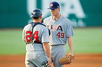 Catcher Josh Elander #24 (Texas Christian) of the USA Baseball Collegiate National Team chats with his starting pitcher Eric Anderson #49 (Missouri) at the USA Baseball National Training Center on July 2, 2011 in Cary, North Carolina.  The College National Team defeated the 18u team 8-1.  Brian Westerholt / Four Seam Images