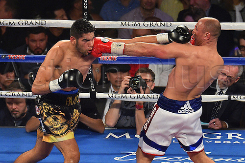 09.04.2016. Las Vegas, Nevada, USA. Gilberto Ramirez (R)  (Mex) throws punch during the Abraham versus Ramirez WBO Super Middleweight World Championship fight in the MGM Grand Garden Arena at the MGM Grand Hotel and Casino in Las Vegas, Nevada. Gilberto Ramirez defeated Arthur Abraham by unanimous decision.