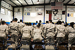December 13, 2008. Erwin, North Carolina.. The troops stand at the end of the ceremony.. A deployment ceremony was held at Cape Fear Christian Academy for B Company 230th Brigade Support Battalion headquartered in Dunn, NC.. The unit is part of the North Carolina National Guard's 30th Heavy Brigade Combat Team, which has 4000 soldiers  deploying to Iraq in April after training. The 30th was last deployed to Iraq in 2003-2005.