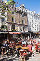 Paris, France. 09.05.2015. People eating outside in the Spring sunshine in the Square Saint-Médard, Rue Mouffetarde, 5th Arrondissement, Paris, France. Photograph © Jane Hobson.