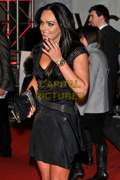 "TAMARA ECCLESTONE .Attending the ""Invictus'"" UK Film Premiere at the Odeon West End cinema, Leicester Square, London, England, January 31st, 2010..arrivals half length dress hand profile gold wrist watch clutch bag black studs studded metal silver smiling ring .CAP/PL.©Phil Loftus/Capital Pictures"