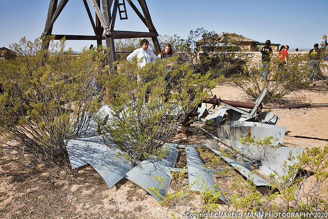 Visitors to the Trintiy Atomic Bomb Test Site near Socorro, NM, examine the ruins of a windmill at the McDonald cabin which is  a part of the  complex where the historic teste wre  conducted in 1944.
