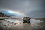 Hug Point State Park, Oregon:<br /> Tidal pools on the beach at Hug Point on a cloudy dawn