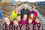 Pictured at the site for a new national school in Ballybunion on Friday which will an amalgamation of the existing schools Scoil Pio Naofa and Saint Josephs. Front from left Fionnan Toomey, Ryan Downey, Padraig Holly, Laura Rohan, Rachen Hanrahan, Rachel Stack and Rebecca Kennelly. Back Eileen Walsh Teacher Scoil Pio Naofa Fr. Martin Hagerty and Noreen Griffin Teacher Saint Josephs.