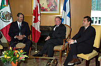 Montreal, April 20, 2001<br /> The President of the United Mexican States ; His Excellency Vincente Fox Quesada (left) pose for photographers with Quebec Premier, the Honorable Bernard Landry,and Gilles Baril ; Quebec Minister of Industry and Comerce,  April 20, 2001 in Montreal, CANADA.<br /> President Fox will attend the Quebec Summit of the Americas lopening today.<br /> Photo : Pierre Roussel