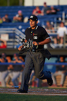Umpire Jose Matamoros during a game between the State College Spikes and Batavia Muckdogs August 22, 2015 at Dwyer Stadium in Batavia, New York.  State College defeated Batavia 5-3.  (Mike Janes/Four Seam Images)