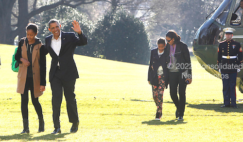 United States President Barack Obama waves to the press as he walks with daughter Malia as the First Family returns to White House from their Hawaiian vacation on Sunday, January 6, 2013.  First lady Michelle Obama walks with daughter Sasha from Marine One to the White House. .Credit: Dennis Brack / Pool via CNP