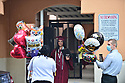 PEMBROKE PINES, FL - MAY 15: Student Kayli Trexler greeted by her family and friend after the graduation ceremony at Pembroke Pines Charter High School on May 15, 2020 in Pembroke Pines, Florida.Because of social distancing mandates instituted by the state to curtail the spread of COVID-19, the 2020 graduates received their diplomas in a near-empty auditorium with no friends, family or relatives allowed to attend. A video of each student walking the stage to receive their diploma will be streamed on the school's scheduled graduation date of May 29.  ( Photo by Johnny Louis / jlnphotography.com )