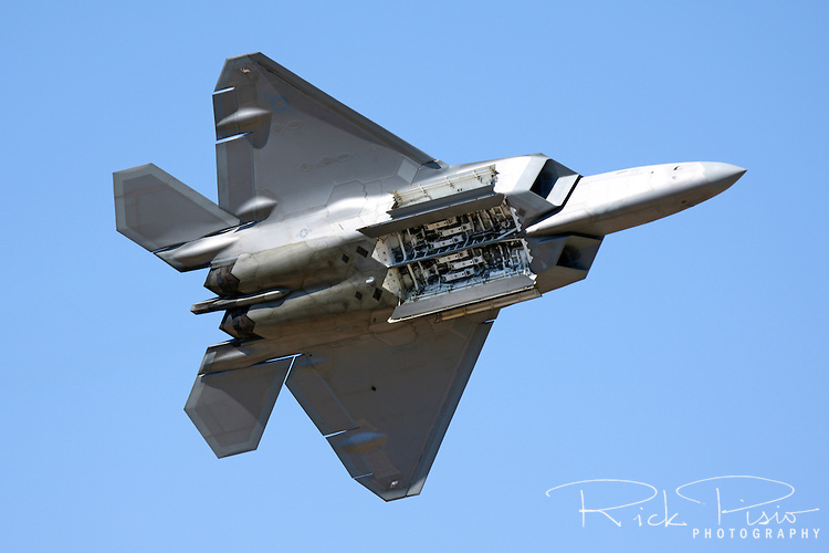 """United States Air Force pilot  Major Paul """"Max"""" Moga displays the weapons bay of the F-22 Raptor as part of an airpower demonstration during the 2008 Reno National Championship Air Races at Stead Field in Nevada."""