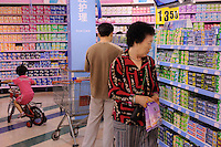 Locals shop for toothpaste on a sunday afternoon in Shenyang, China. The British retailer is undergoing an aggressive expansion and attempting to capture the growing middle class market in food and other domestic merchandise in China..