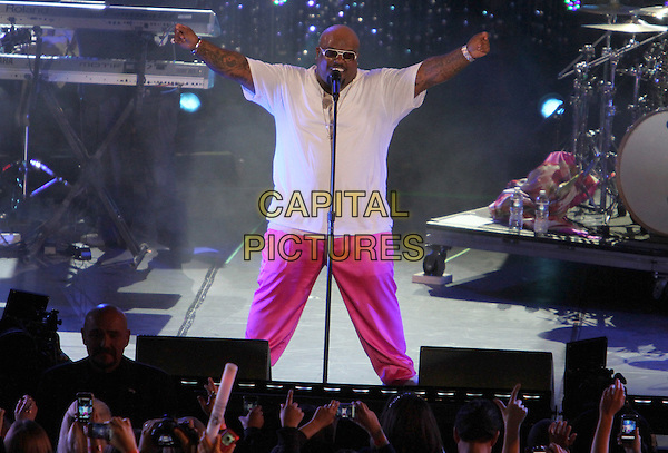 "Cee Lo Green (Thomas DeCarlo Callaway).Caesars Entertainment Kick-Off Of ""Escape To Total Rewards"" , Los Angeles Show Held At Hollywood & Highland Center, Hollywood, California, USA, 1st March 2012..music concert gig live on stage  half 3/4 length pink trousers white t-shirt sunglasses  performing microphone singing hands arms .CAP/ADM/KB.©Kevan Brooks/AdMedia/Capital Pictures."