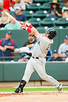 Adalberto Ibarra #20 of the Salem Red Sox follows through on his swing against the Winston-Salem Dash at BB&T Ballpark on May 5, 2012 in Winston-Salem, North Carolina.  The Red Sox defeated the Dash 6-4.  (Brian Westerholt/Four Seam Images)
