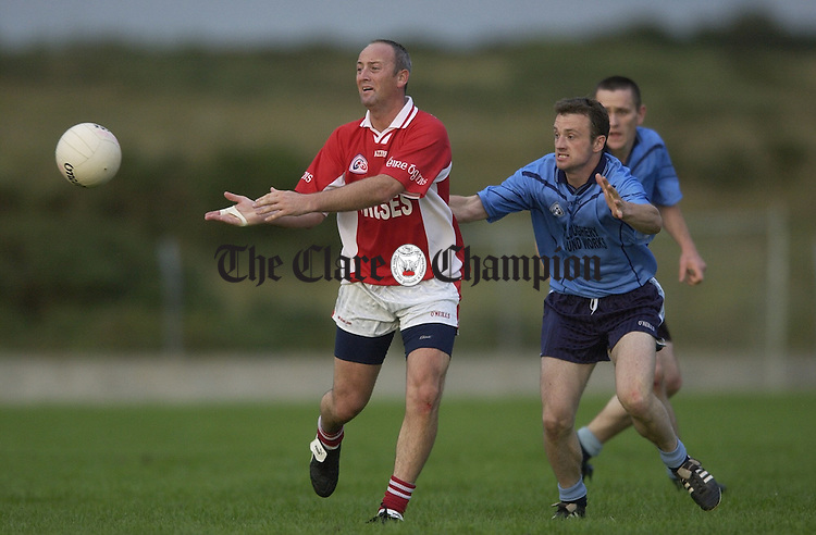 Albert Hardiman of Eire Og gets the ball away during the Intermediate county semi-final at Kilmihil. Photograph by John Kelly.6