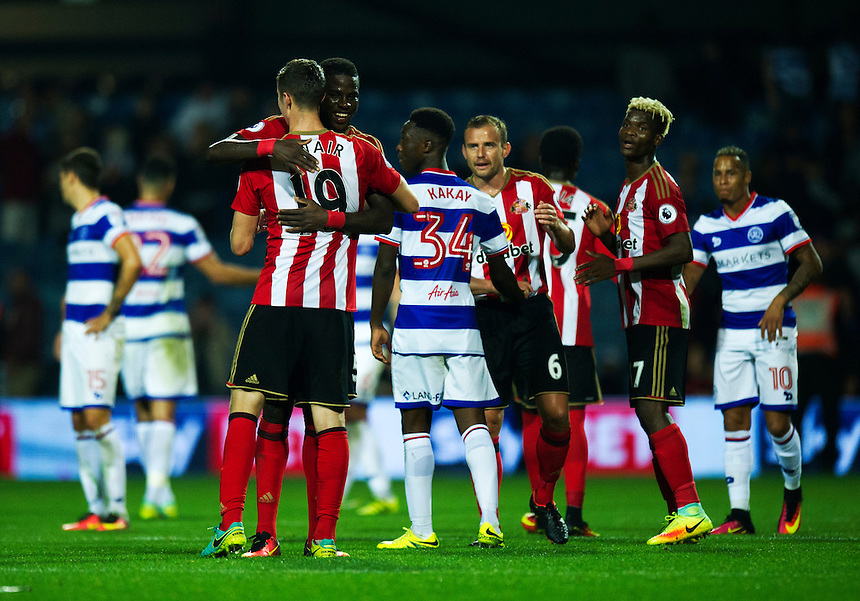 Sunderland's Paddy McNair (19) celebrates with Papy Djilobodji at the final whistle after their 2-1 victory over Queens Park Rangers<br /> <br /> Photographer Ashley Western/CameraSport<br /> <br /> The EFL Cup Third Round - Queens Park Rangers v Sunderland - Wednesday 21st September 2016 - Loftus Road - London<br />  <br /> World Copyright &copy; 2016 CameraSport. All rights reserved. 43 Linden Ave. Countesthorpe. Leicester. England. LE8 5PG - Tel: +44 (0) 116 277 4147 - admin@camerasport.com - www.camerasport.com