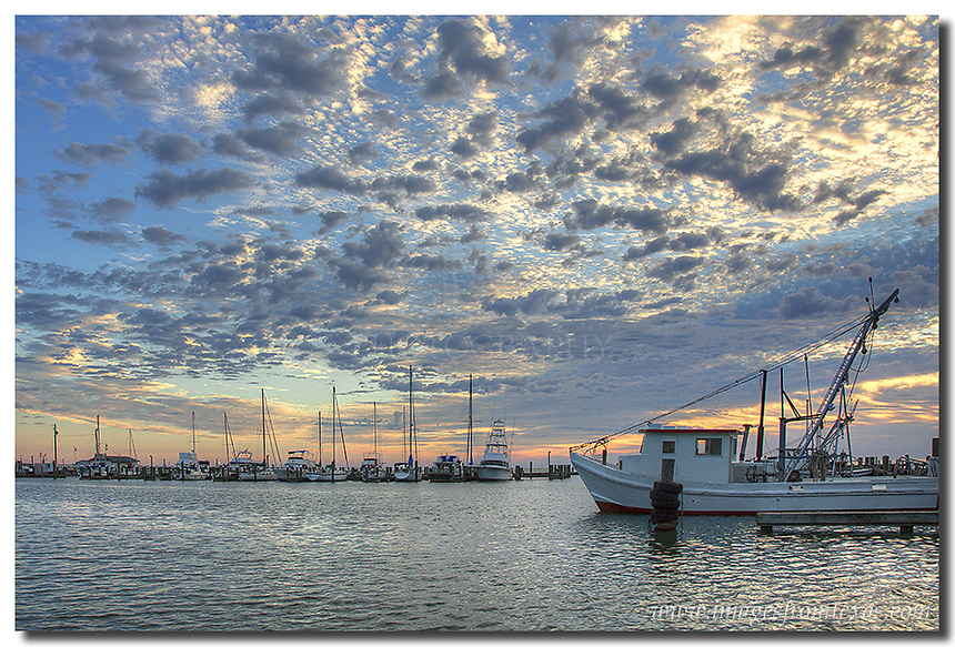 Amazing clouds filled the skies on this morning along the Texas coastline. This Rockport image comes from late fall, and boats rested quietly as the waves gently rolled in from the Gulf of Mexico.