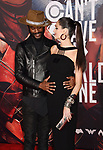 HOLLYWOOD, CA - NOVEMBER 13: Musician Gary Clark Jr. (L) and wife/model Nicole Trunfio arrive at the Premiere Of Warner Bros. Pictures' 'Justice League' at the Dolby Theatre on November 13, 2017 in Hollywood, California.