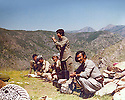 Iraq 1981 .Congress of Komala in the mountains, standing, Hatige Yachar and next to her, Nou Shirwan  .Irak 1981 .Intervention de Hatige Yachar pendant le congres du Komala dans les montagnes, au premier plan Nou Shirwan