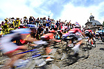 The peloton fly up the Muur Kapelmuur in Gerarrdsbergen during Stage 1 of the 2019 Tour de France running 194.5km from Brussels to Brussels, Belgium. 6th July 2019.<br /> Picture: ASO/Alex Broadway | Cyclefile<br /> All photos usage must carry mandatory copyright credit (© Cyclefile | ASO/Alex Broadway)
