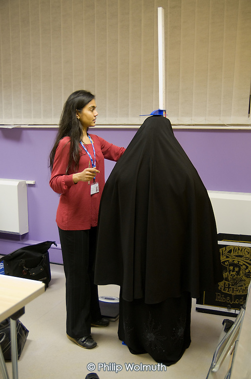 Nurtitionist Chetali Agrawal gives advice at a Weigh-in clinic during a Healthy Futures drop-in session at Queens Park Court Community Hall, West London