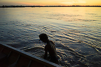 November 6, 2014 - Koh Pdao, Kratie (Cambodia). A young kid has a bath in the water in front of Koh Pdao village.