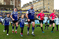 Henry Thomas of Bath Rugby mascot in hand runs out onto the field. Gallagher Premiership match, between Bath Rugby and Harlequins on March 2, 2019 at the Recreation Ground in Bath, England. Photo by: Patrick Khachfe / Onside Images