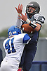 Port Washington No. 41 James Dalimonte, left, breaks up a pass intended for Plainview JFK No. 44 Brendan Fitzpatrick during a Nassau County Conference I varsity football game at Plainview JFK High School on Saturday, October 3, 2015. Plainview JFK won by a score of 42-0.<br /> <br /> James Escher