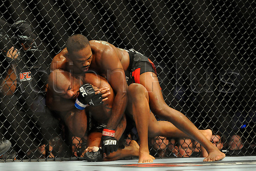 "24.09.2011. Denver, Colorado. Jon ""Bones"" Jones gets into the final chokehold he needed to defeat Quinton ""Rampage"" Jackson during UFC 135 at the Pepsi Center in Denver, Colorado."