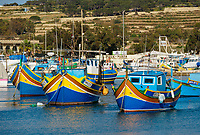 Bunte Fischerboote treiben am Sonntag, 16.04.2017, im Hafen von Marsaxlokk / Malta. | Colourfull fishing boats in the Marsaxlokk harbour on Sunday, 2017-04-16, on the island of Malta.  [ (c) Rainer Raffalski, Tinkhofstr. 19, 45731 Waltrop, Germany, www.Rainer-Raffalski.de, email Rainer.Raffalski@gmx.de, Tel.+Fax 0049-2309-70002, mobil 0049-171-5448541. Jegliche Nutzung ist honorarpflichtig (+7%Mwst.), Urhebervermerk und Belegexemplar obligatorisch. Honorar gemaess den aktuellen Honorarempfehlungen der Mittelstandsgemeinschaft Foto-Marketing (MFM), wenn nicht vor der Nutzung anders vereinbart. Konto 360 46 720, Sparkasse Vest Recklinghausen, BLZ 426 501 50.  Steuer-Nr. 340/5269/0086, Finanzamt Recklinghausen. Any use requires purchase of license. Fees according to current MFM-recommendations, if no other agreement is settled prior to use. International Bank Account Number DE64 4265 0150 0036 0467 20, SWIFT-BIC.: WELADED1REK. www.freelens.com/clearing ] [#0,26,121#]