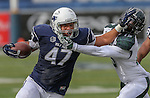 Nevada tight end Jarred Gipson (47) stiff arms Hawaii defender Daniel Lewis Jr. (15) as he carries the ball during the first half of an NCAA college football game in Reno, Nev., on Saturday, Oct. 24, 2015. (AP Photo/Cathleen Allison)