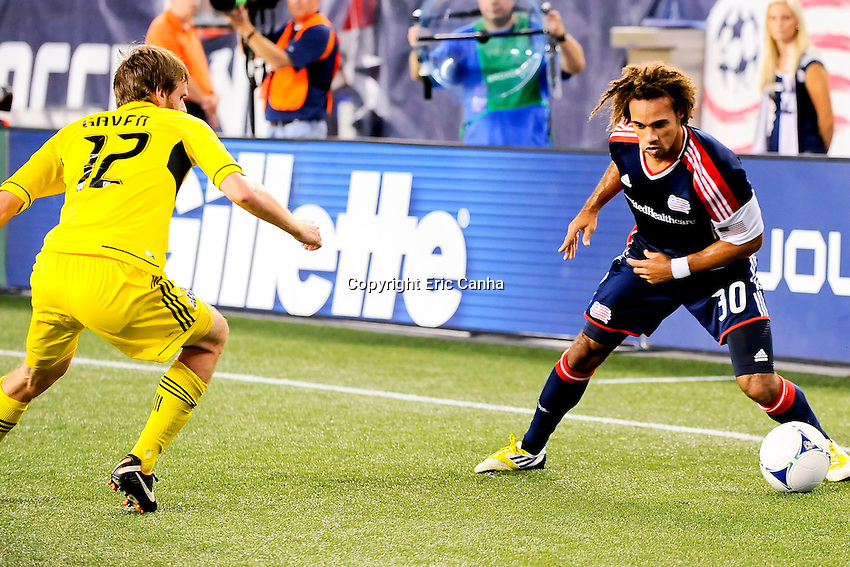 September 5, 2012 Columbus Crew midfielder/forward Eddie Gaven #12 and New England Revolution defender Kevin Alston #30 in game action during the New England Revolution vs Columbus Crew MLS game held at Gillette Stadium, in Foxborough, Massachusetts.  Eric Canha/CSM