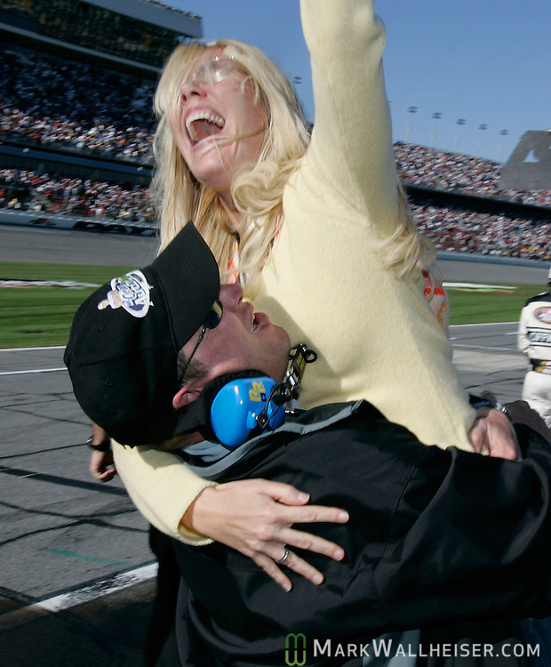 Tony Stewart crew chief Butch Hilton lifts Delana Harvick, owner of the #33 Chevrolet driven by Tony Stewart and wife of driver Kevin Harvick after Stewart won the Hershey's Take 5 300 at Daytona International Speedway Saturday February 19, 2005.